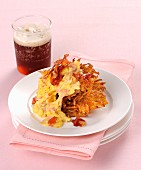 Scrambled egg and bacon on a Rösti (fried Swiss potato cake)