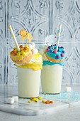 Banana freak shakes with colourful mini doughnuts for a children's party