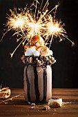 A chocolate freak shake with marshmallows and sparklers
