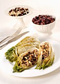 Stuffed endives with olives, raisins and pine nuts