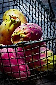 Fresh prickly pears in a wire basket