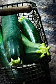 Several courgettes in a wire basket