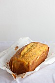 An orange and poppy seed loaf on baking paper