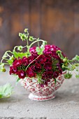 A bowl with Sweet William flowers and strawberries