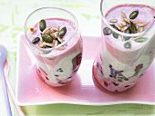 Layered berry and yoghurt dessert with mixed seeds