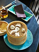 Dim sum in a steamer basket as a dish at the Town restaurant in Johannesburg