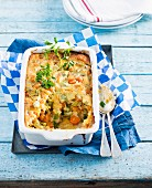 Chicken cobbler with chicken, carrots, leek and broad beans
