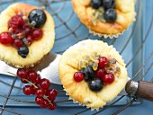 Passion fruit muffins with quark and fresh berries