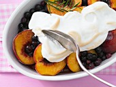 Blueberry and peach compote with maple syrup, topped with meringue