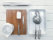 Various kitchen utensils: blenders, mixing cups and dough scrapers