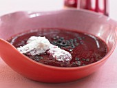 A chilled elderberry dish with coconut sauce