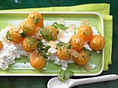 A melon salad with fresh cheese and a sweet and sour coriander dip