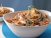 Spaghetti with fish, vegetables and coconut sauce
