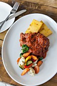 Italian oxtail ragout with polenta and vegetables