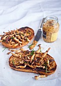 Forest mushrooms with garlic and mustard on toasted rye bread