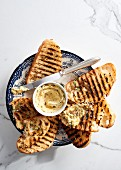 Toasted bread with anchovy, rosemary and Parmesan butter