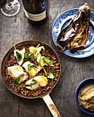 Fried monkfish on a bed of lentils with aubergine