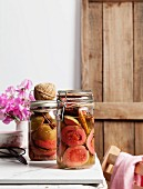 Spiced preserved guavas in a preserving jar
