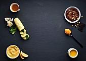 Verschiedene Buttersorten (Gewürzbutter, Nussbutter, Kräuterbutter, Zitronenbutter, Schokoladen-Haselnuss-Butter, Getrocknete-Tomaten-Butter, Sardellenbutter)