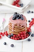 Gluten-free buckwheat pancakes with vanilla sauce and berries