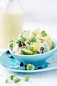 Potato salad with cucumber and curry and yoghurt dressing