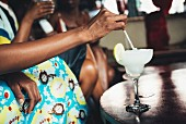 Dark-skinned people with a cocktail at the Potato Shed restaurant (Johannesburg, South Africa)