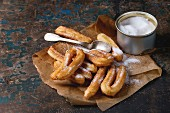 Spanish churros with granulated sugar on baking paper