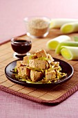 Asian tofu with leek, sesame seeds and soy sauce