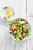 Lambs lettuce salad with avocado and smoked salmon
