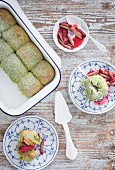 Matcha buns with rhubarb compote on assorted plates