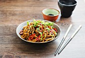 Udon noodles with peanut sauce and pea sprouts