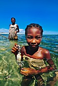 Vezo girl collecting squid in lagoon