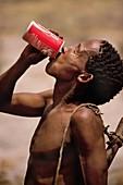 Bushman drinking Coca Cola