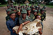 Park wardens with white rhino skull