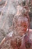 Himba woman at campfire,Namibia