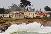 Winter surf hitting coastline,California