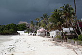 Dark clouds over a tropical beach