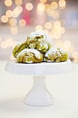 Snowball biscuits wit matcha and white chocolate on a small cake stand