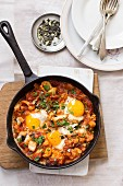 Shakshuka with cauliflower, parsley and pumpkin seeds