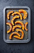 Oven-baked Hokkaido pumpkin wedges with sea salt and sunflower seeds