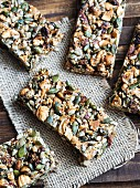 Homemade gluten-free paleo nut bars on a wooden table