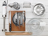 Kitchen utensils for making a plum cake with chocolate cornflakes