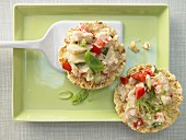 Artichoke cream on corn waffles with tomatoes, basil and almonds