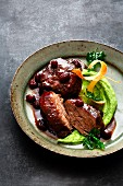 Sauerbraten (marinated pot roast) of calf's cheek with raisins and parsley root purée