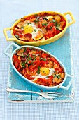 Shakshuka with vegetables, egg and salami