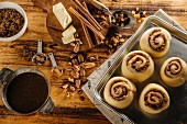 Unbaked cinnamon buns and ingredients