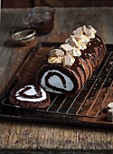 A chocolate Swiss roll with marshmallows and wafer biscuits