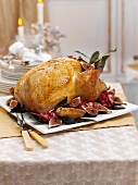 A whole roast turkey with figs and pomegranate for Christmas