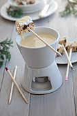 Fondue with vanilla custard and stollen cake cubes