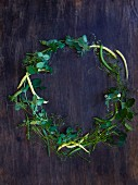 A wreath of beans, sugar snap peas, and pea tendrils